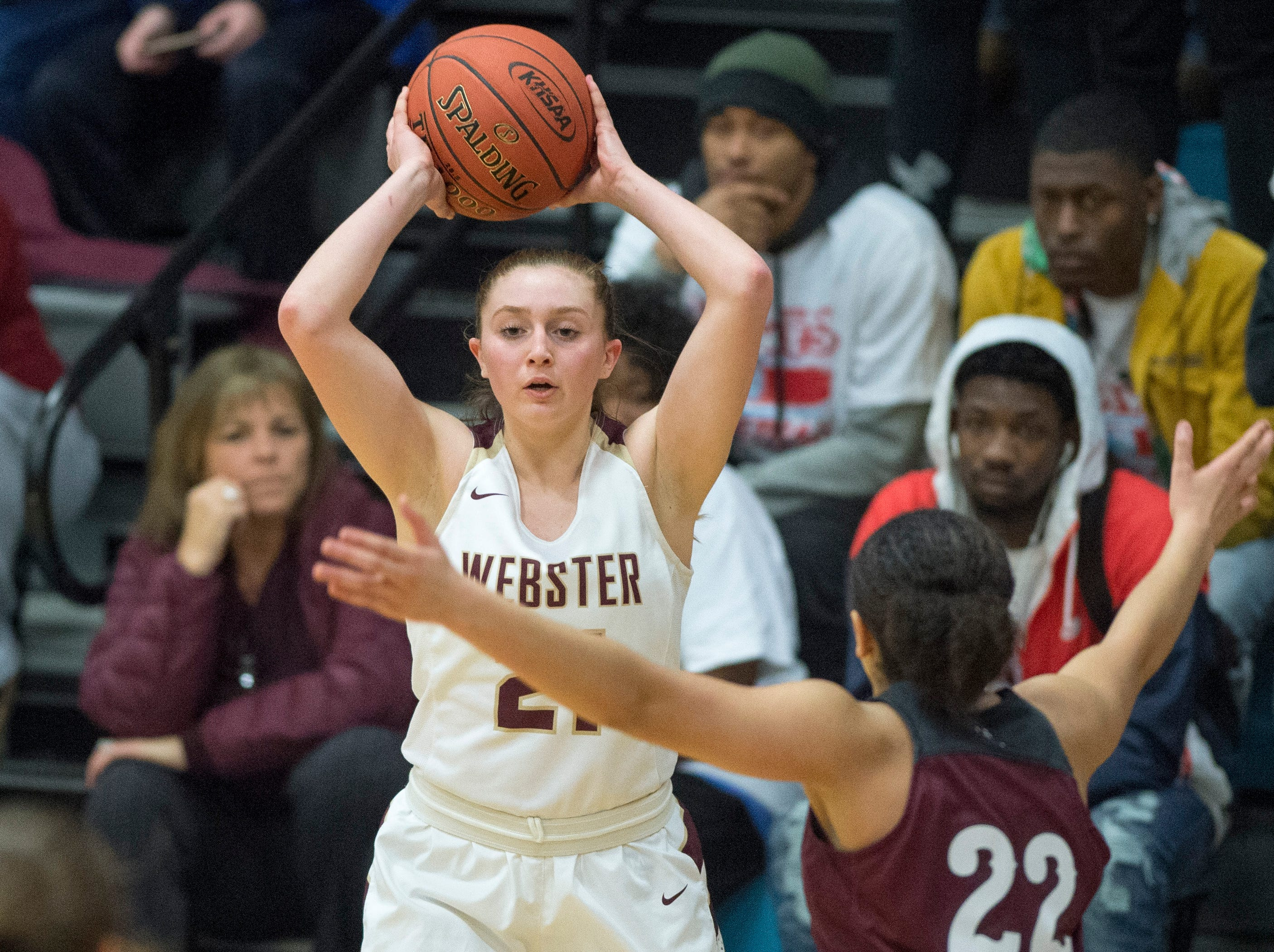 Webster County's Mariah Austin (21)  passes the ball during the 2019 Sixth District championship game against the Henderson County Lady Colonels at Union County High School Thursday, Feb. 21, 2019.