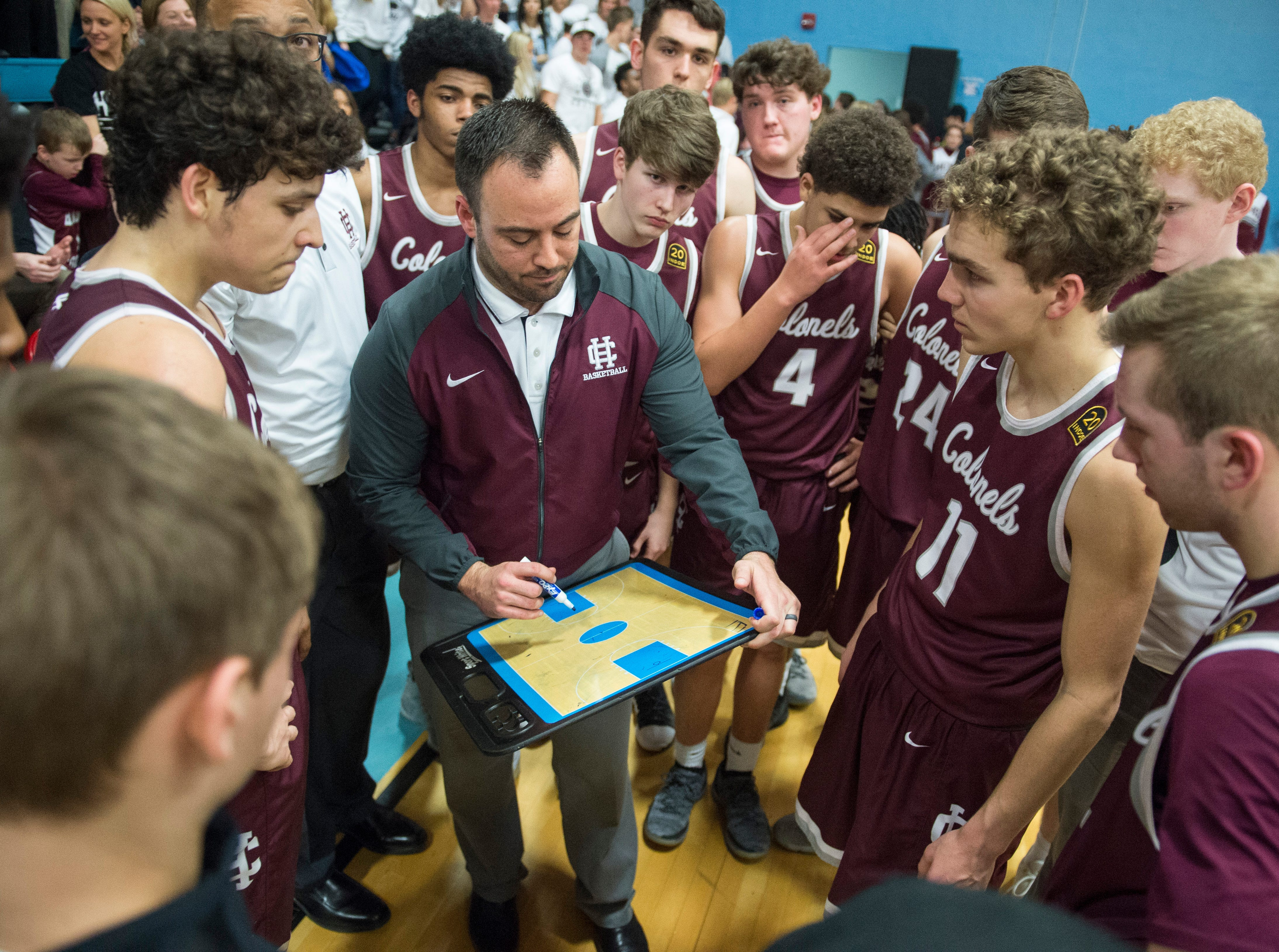 Henderson Head Coach Tyler Smithart gives direction during a timeout of the 2019 Sixth District championship game against the Union County Braves at Union County High School Thursday, Feb. 21, 2019.