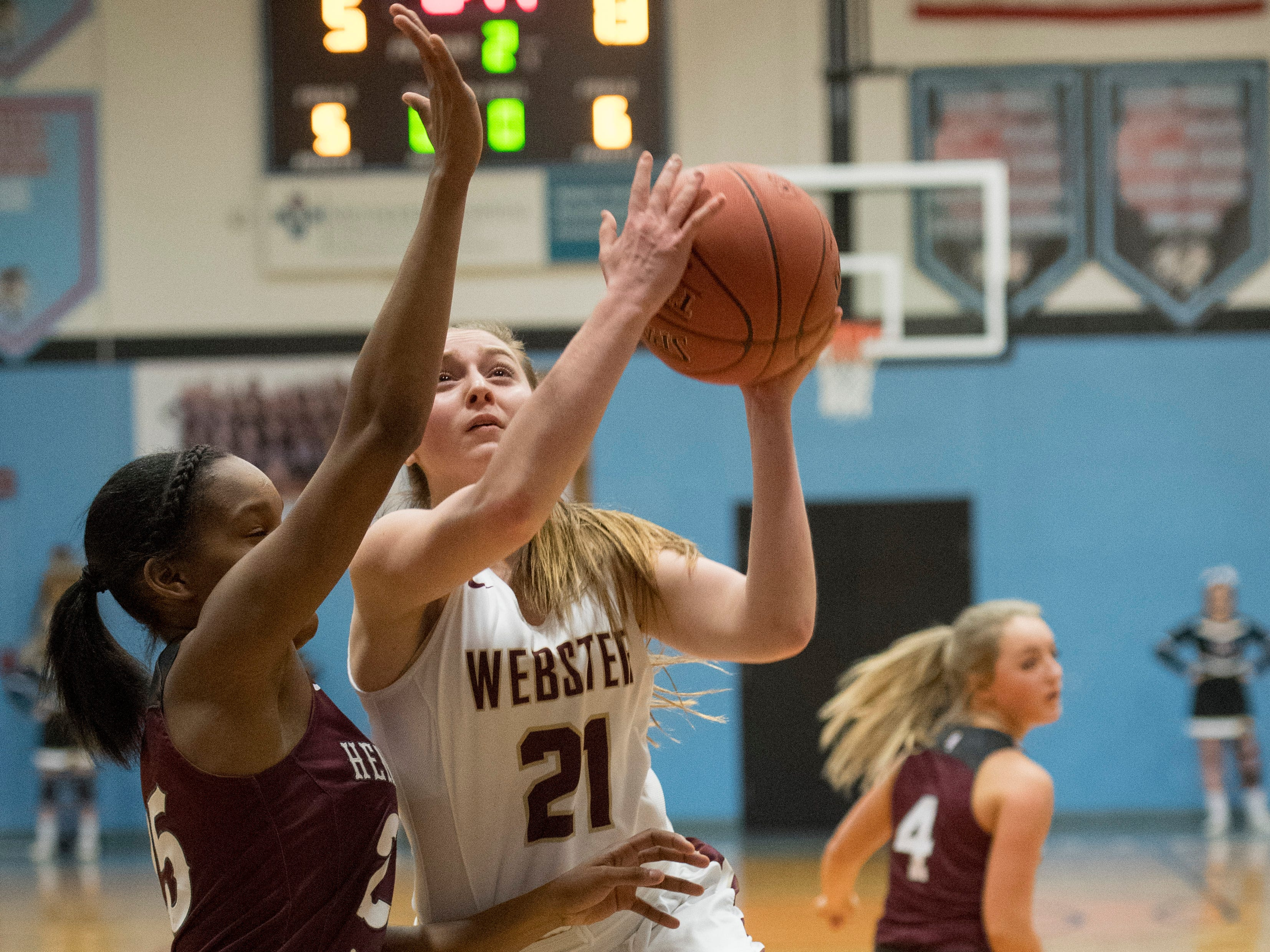 Webster County's Mariah Austin (21) takes a shot during the 2019 Sixth District championship game against the Henderson County Lady Colonels at Union County High School Thursday, Feb. 21, 2019.