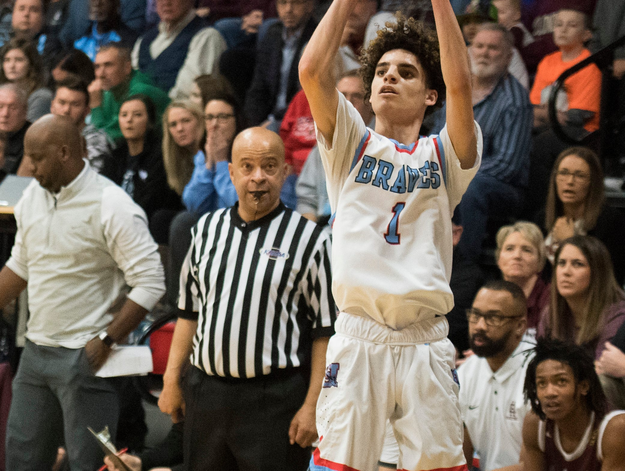 Union County's Eli Wilkes (1) takes a 3-point shot during the 2019 Sixth District championship game against the Henderson County Colonels at Union County High School Thursday, Feb. 21, 2019.