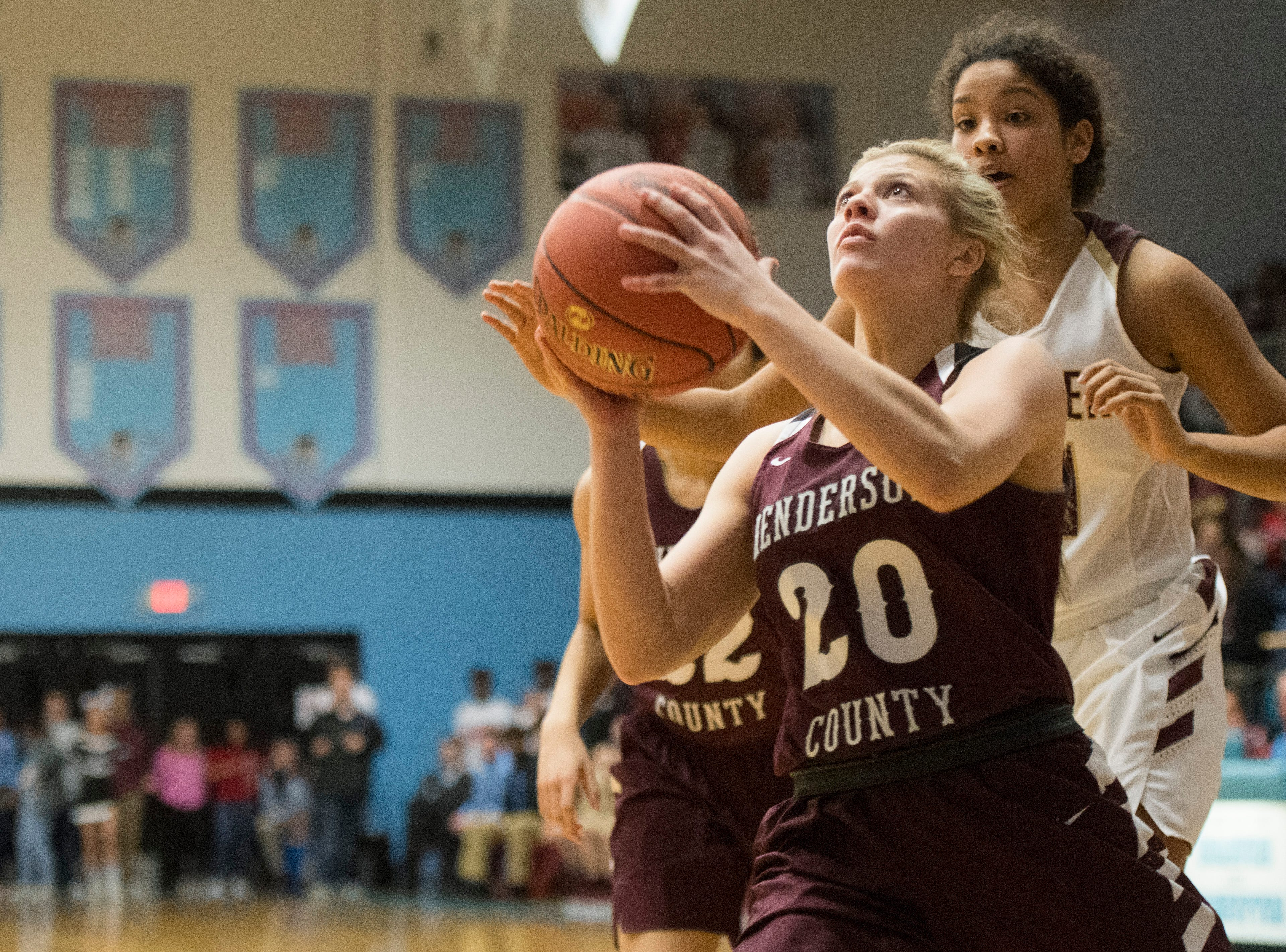 Henderson County's Kaytlan Kemp (20) shots a layup during the 2019 Sixth District championship game against the Webster County Lady Trojans at Union County High School Thursday, Feb. 21, 2019.