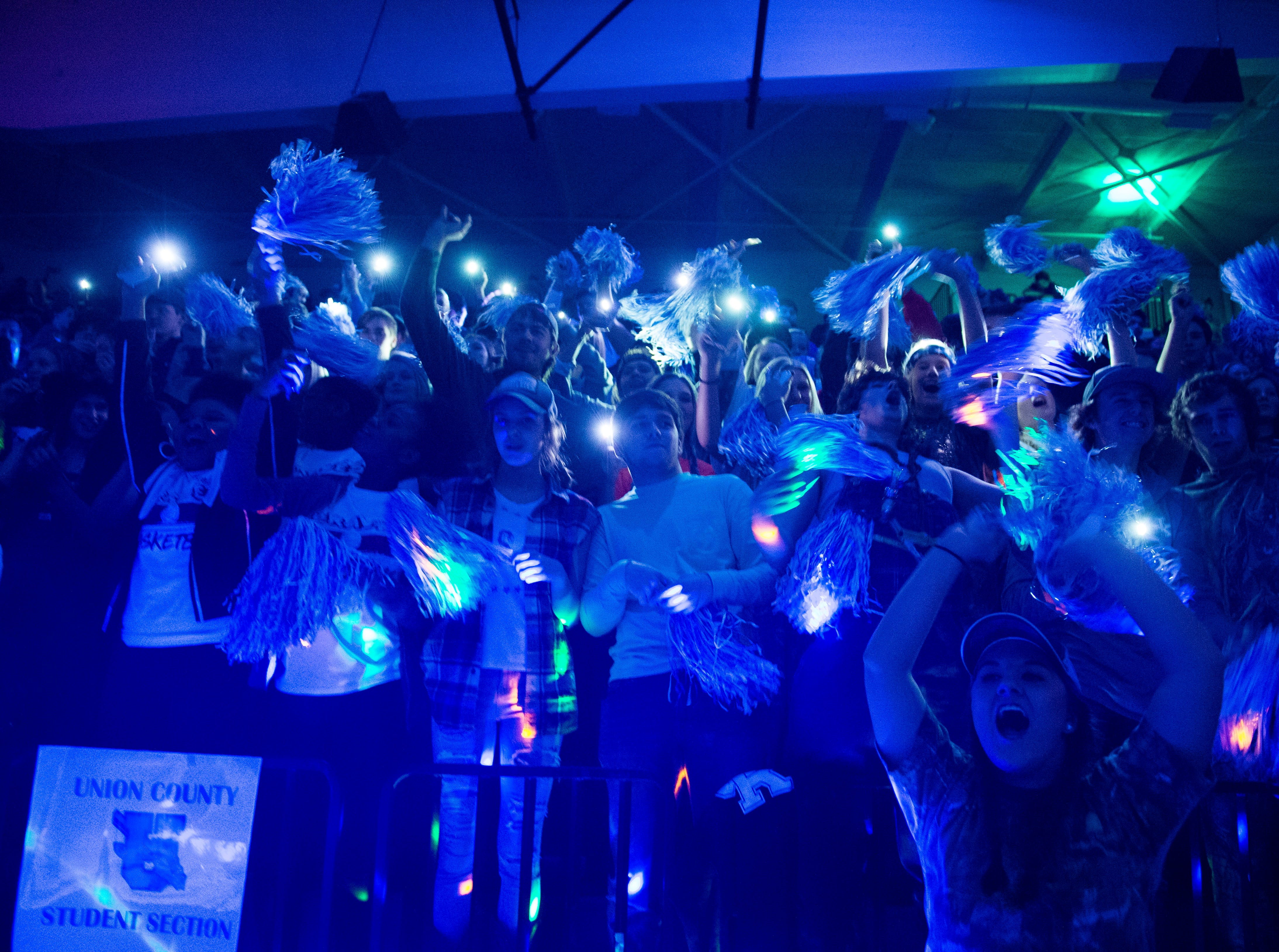 The Union County Braves student sections was lite up during the starting lineup announcement of the 2019 Sixth District championship game against the Henderson County Colonels at Union County High School Thursday, Feb. 21, 2019.