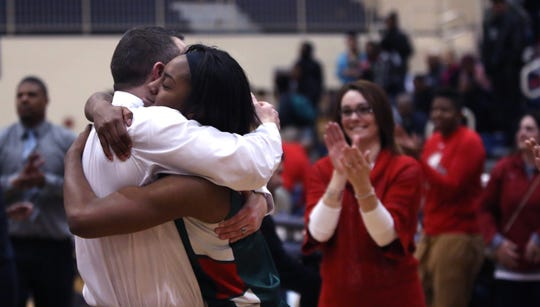 FILE – Lawrence North guard Lamina Cooper gets a big after-game hug from coach Chris Giffin after the Wildcats' regional win in 2015.