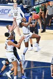 Feb 21, 2019; South Bend, IN, USA; Notre Dame Fighting Irish guard Jackie Young (5) shoots against Duke Blue Devils guard Miela Goodchild (3) in the second half at the Purcell Pavilion.