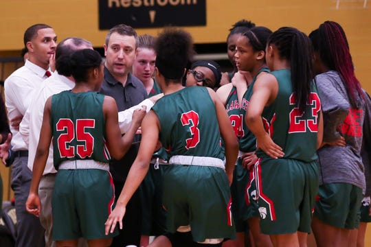 Lawrence North Coach Chris Giffin giving his team instructions during a time out during the second half of Lawrence North vs. Warren Central High School varsity girls basketball held at Warren Central High School, December 14, 2018.