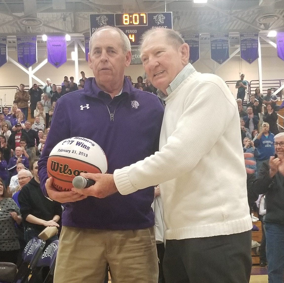 Former Loogootee coach Jack Butcher (right) poses with J.R. Holmes, who broke Butcher's IHSAA wins record on Thursday night.