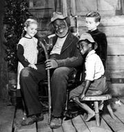 James Baskett (center, as Uncle Remus) and the cast of the 1946 Disney classic SONG OF THE SOUTH.  Credit: Walt Disney Productions.