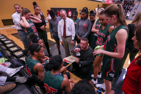 Lawrence North Coach Chris Giffin gives plans to his team for the second half of play during the Lawrence North vs. Warren Central High School varsity girls basketball held at Warren Central High School, December 14, 2018.