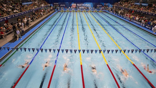 Swimmers compete in a swimming competition at the IUPUI Natatorium in Indianapolis.