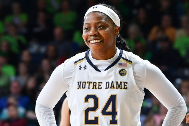 Fighting Irish guard Arike Ogunbowale (24) smiles after a basket in the first half against the Duke Blue Devils at the Purcell Pavilion. The basket made Ogunbowale the all time leading scorer for Notre Dame womens basketball.