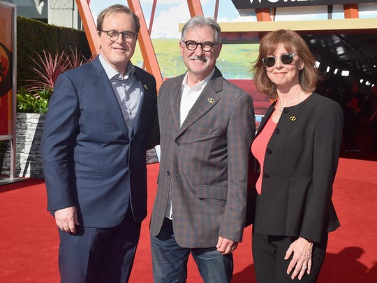 """John Walker, center, served as a producer for """"Incredibles 2,"""" nominated in the category of best animated feature. Walker is flanked by director Brad Bird, left, and fellow producer Nicole Paradis."""