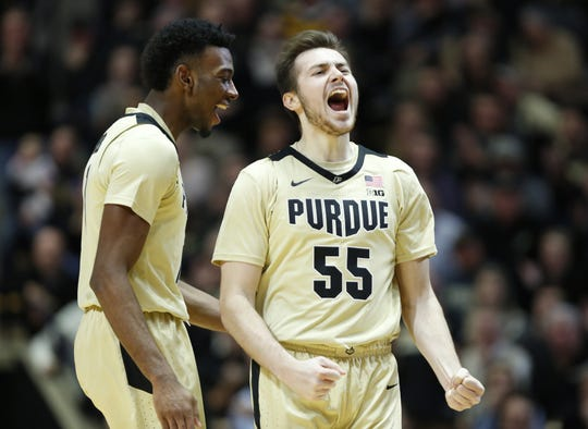 Sasha Stefanovic of Purdue and teammate Aaron Wheeler react after a Maryland turnover with 11:17 remaining December 6, 2018, at Mackey Arena.