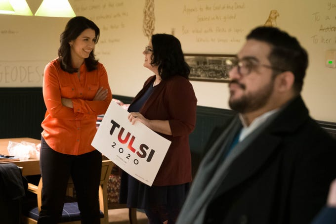 2020 Democratic presidential candidate Tulsi Gabbard, left, chats with Jodi Clemens of West Branch in the lobby of the Graduate in Iowa City on Thursday, February 21, 2019.