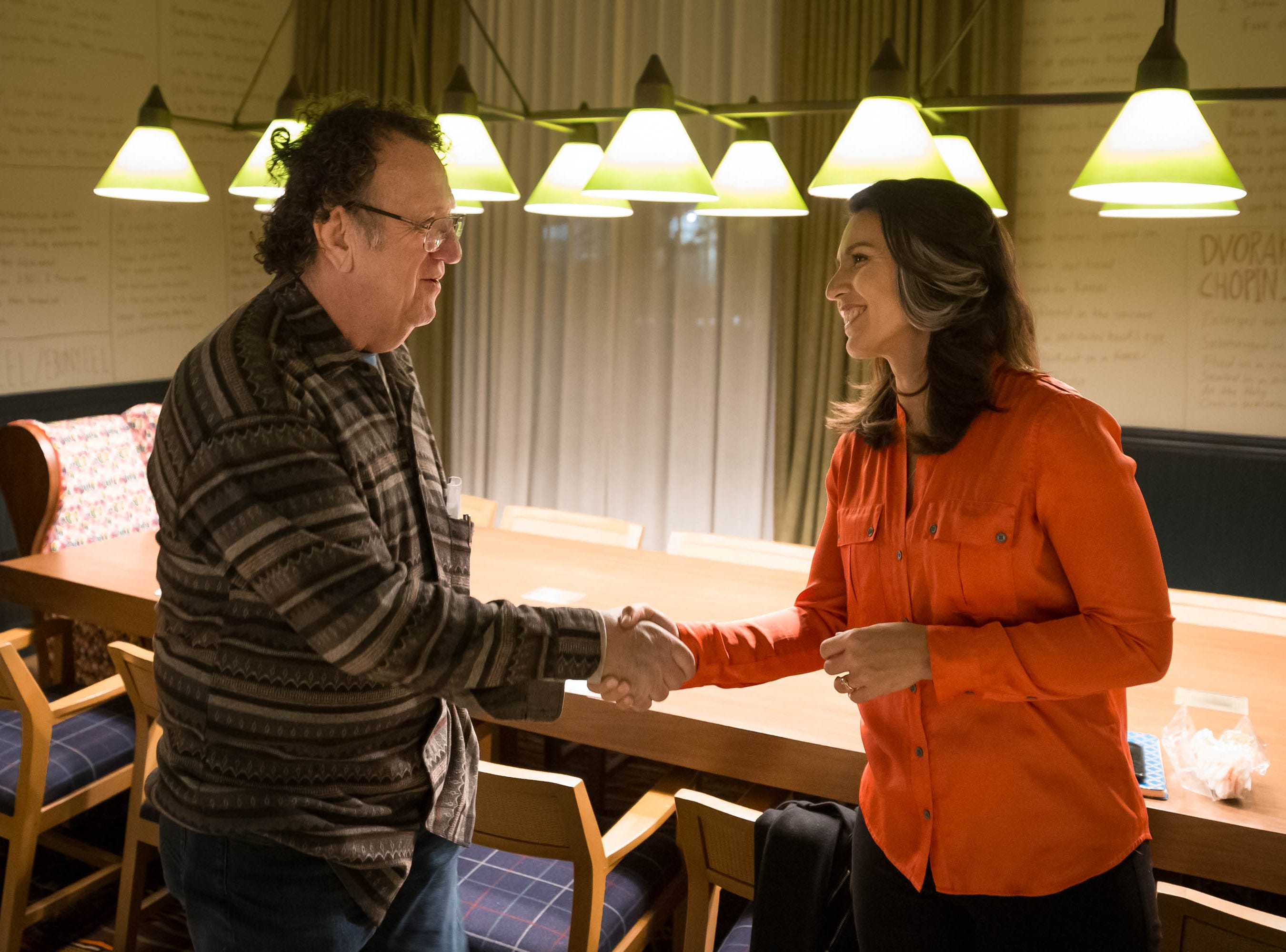 2020 Democratic presidential candidate Tulsi Gabbard, right, meets Bob Arbuckle of Iowa City in the lobby of the Graduate in Iowa City on Thursday, February 21, 2019.
