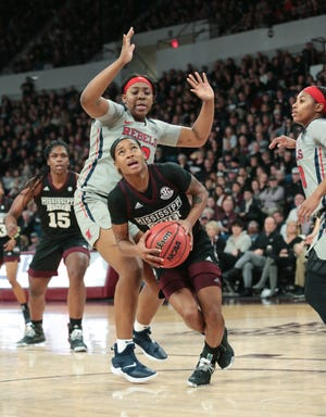 Mississippi State's Jordan Danberry (24) is fouled by Ole Miss's La'Karis Salter (33) in the third quarter of MSU's win over Ole Miss on Sunday, January 27, 2019. The two teams played again on Thursday night, another win for the Bulldogs. Photo by Keith Warren