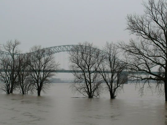A low-lying park sits flooded by the swollen Mississippi River on Friday, Feb. 22, 2019 in Memphis, Tenn. Located on Memphis' Mud Island, Greenbelt Park (pictured) floods when the Mississippi River reaches high levels.