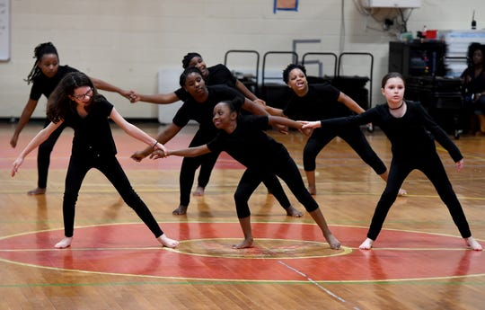 "East Elementary School's 5th Grade Allstars dance to ""Black Butterfly"" during the school's 2019 Black History Month program, Thursday, Feb. 21."