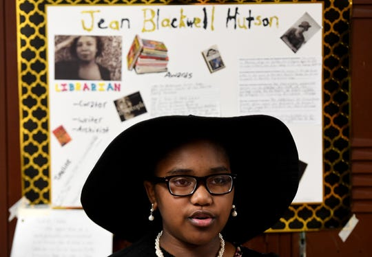 East Elementary School 4th grader Khaliah Wade reads about Jean Blackwell Hutson during the school's Black History Month living history museum, Thursday, Feb. 21.