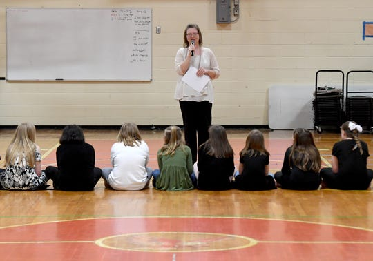 "East Elementary School teacher Leeann Brigman sings ""The Greatest Love of All"" to students during the school's 2019 Black History Month program, Thursday, Feb. 21."