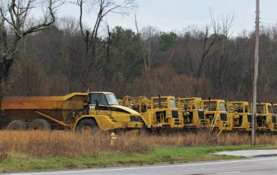 Heavy equipment is staged along Kingston Pike in preparation for groundbreaking of the access road for Ivey Farms subdivision.