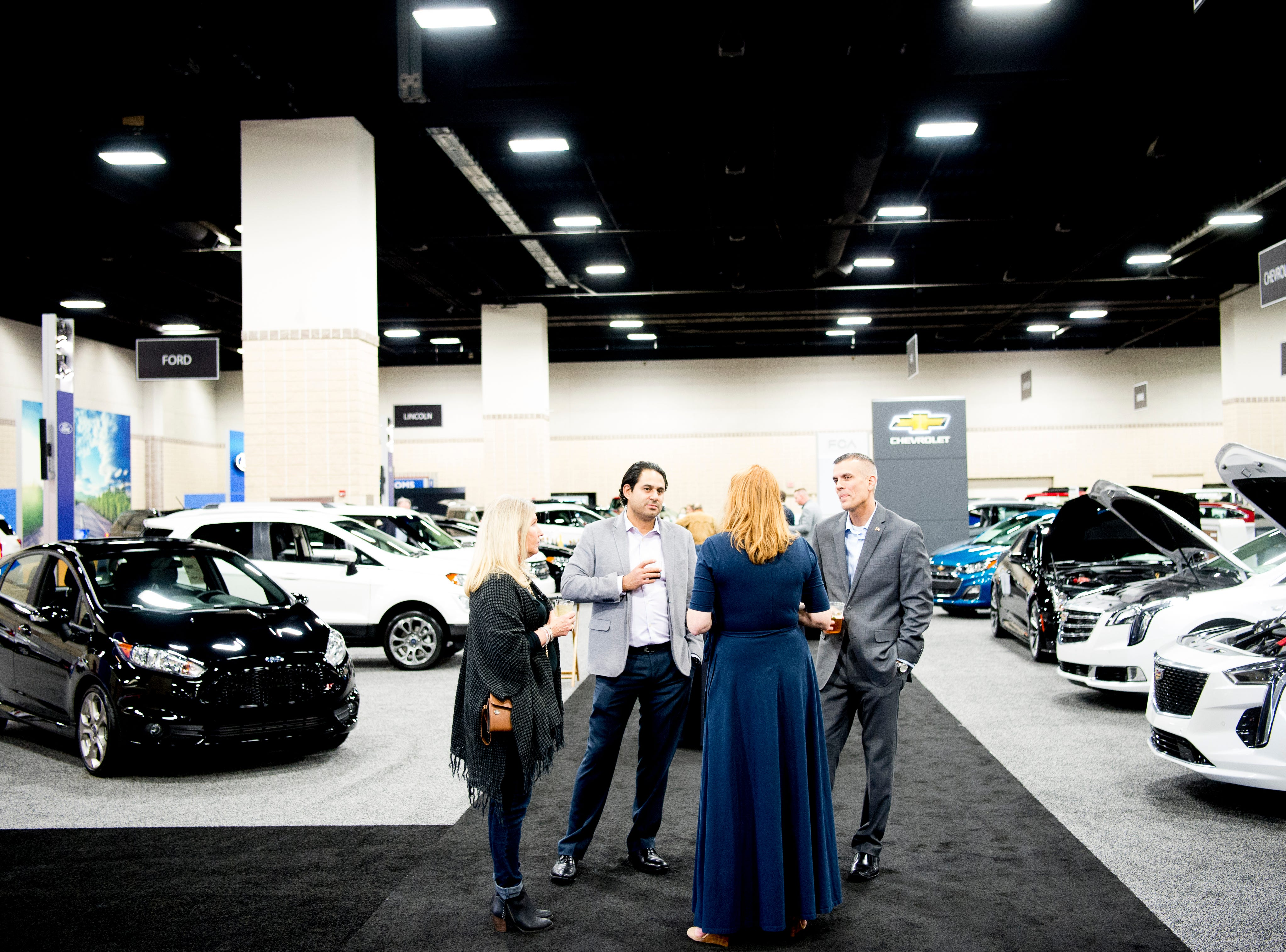 Attendees mingle at the Knox News Auto Show preview party in the Knoxville Convention Center in Knoxville, Tennessee on Thursday, February 21, 2019.