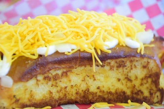 The Wagon – a loaded baked potato meets hot dog. It features fried potato, sour cream, and cheese at D & B Hot Dogs.