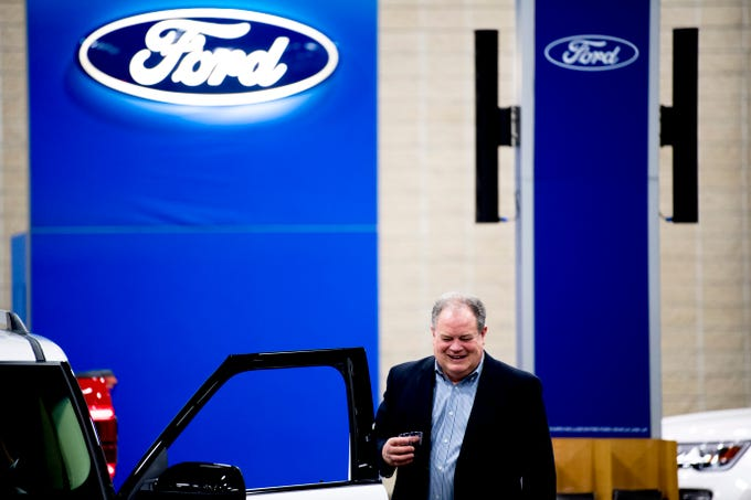 Peter Alexander shares a laugh while looking at a Ford Flex at the Knox News Auto Show preview party in the Knoxville Convention Center in Knoxville, Tennessee on Thursday, February 21, 2019.