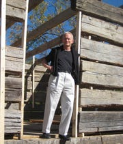 David Grant Howard during the re-assemblage of this circa 1792 log house in his hometown of Greeneville, Tenn. Nov. 6, 2011.