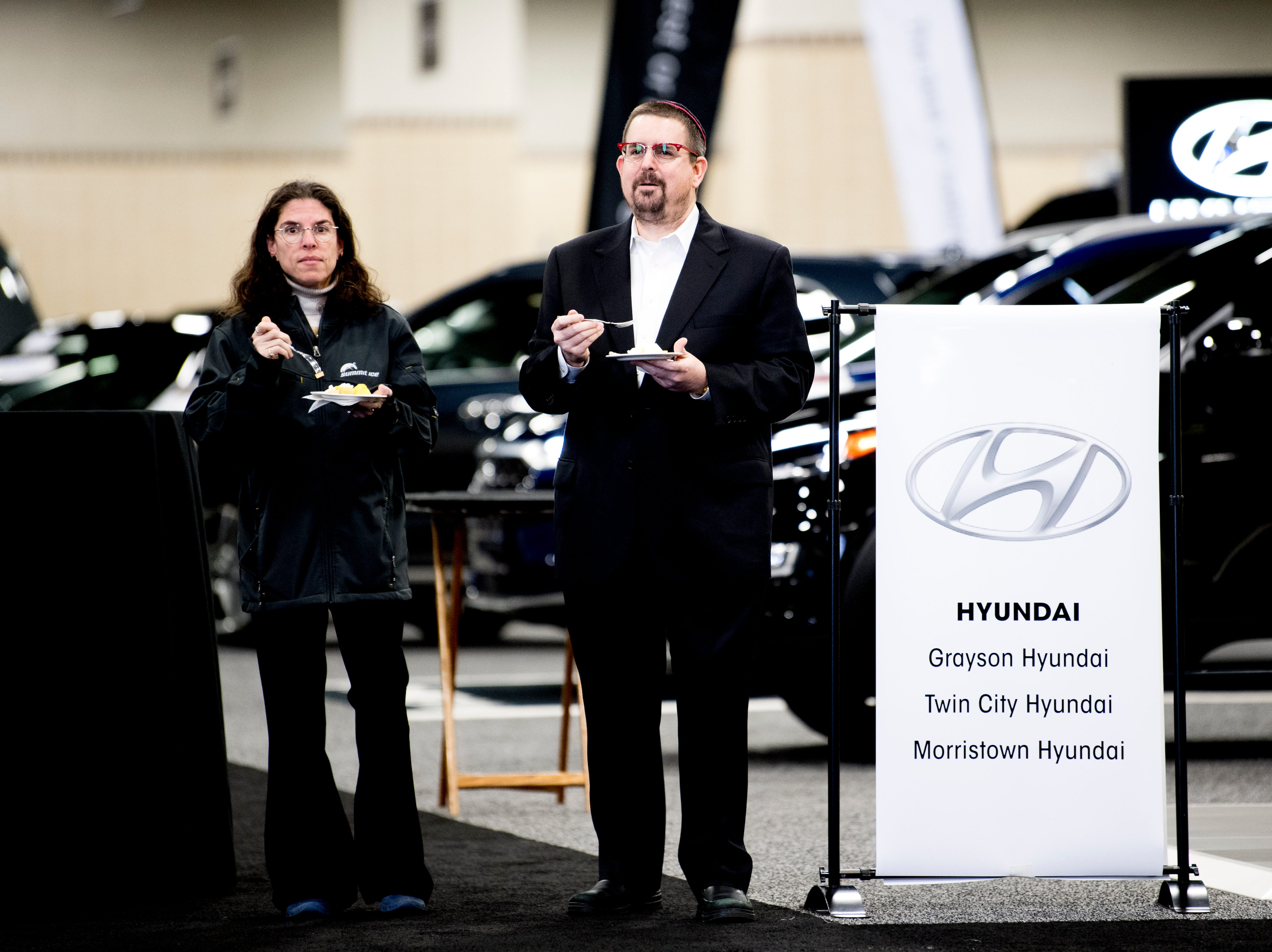 Batya Boxt, left, and Rabbi Erin Boxt, of Rocky Hill, look at vehicles at the Knox News Auto Show preview party in the Knoxville Convention Center in Knoxville, Tennessee on Thursday, February 21, 2019.