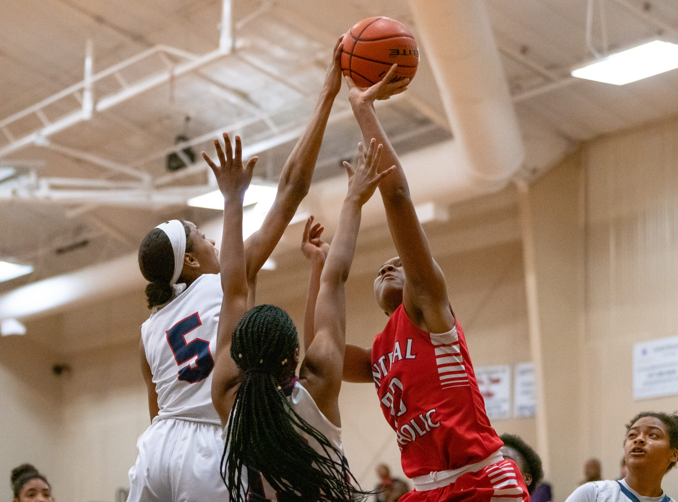 Central Catholic's Yani Johnson gets blocked while taking a shot as the LCA Knights take on the Central Catholic Eagles at home on Thursday, Feb. 21, 2019.