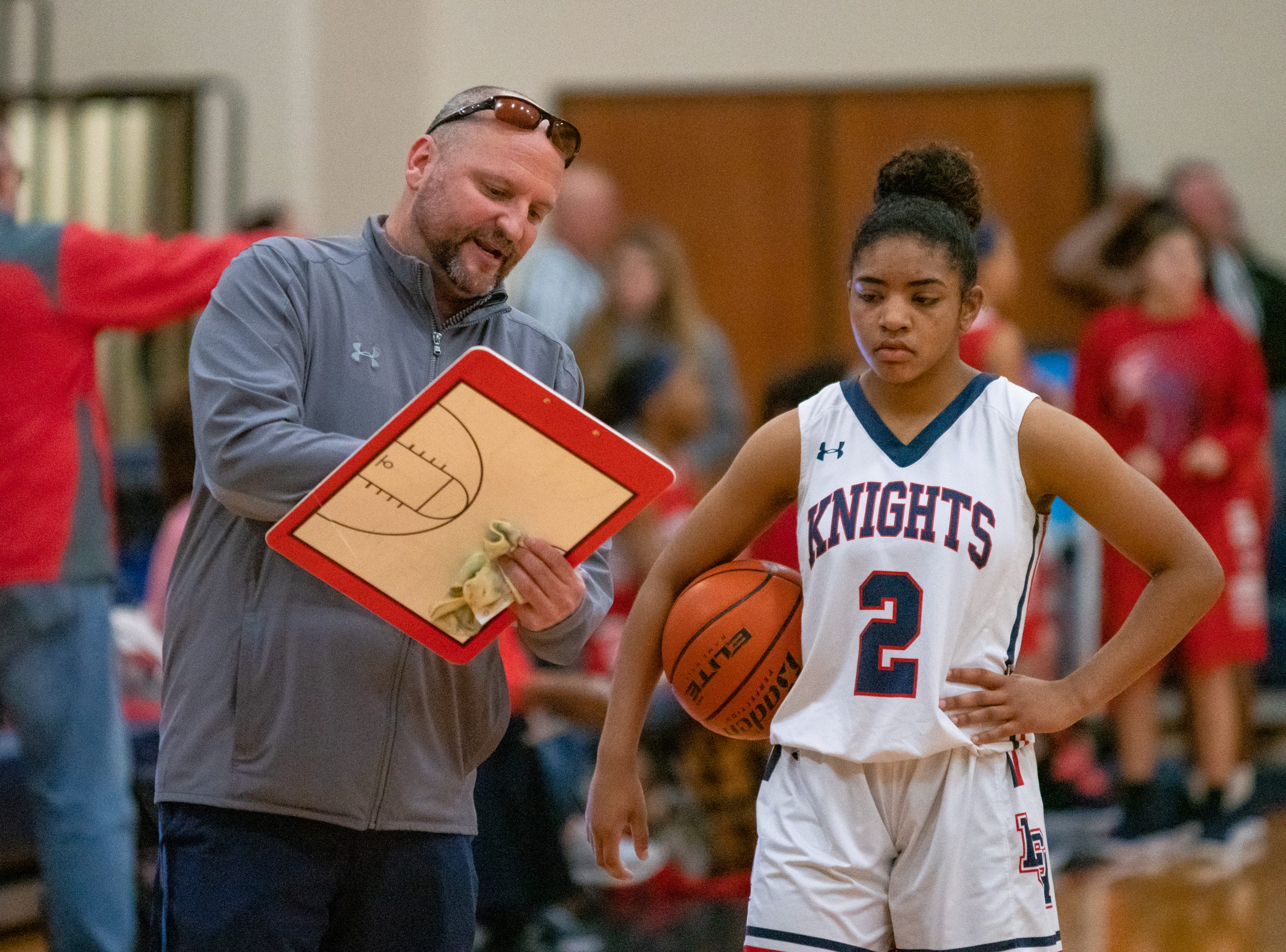 Lafayette Christian head coach Devin Lantier talks to Zoe Wiltz during half-time as the LCA Knights take on the Central Catholic Eagles at home on Thursday, Feb. 21, 2019.