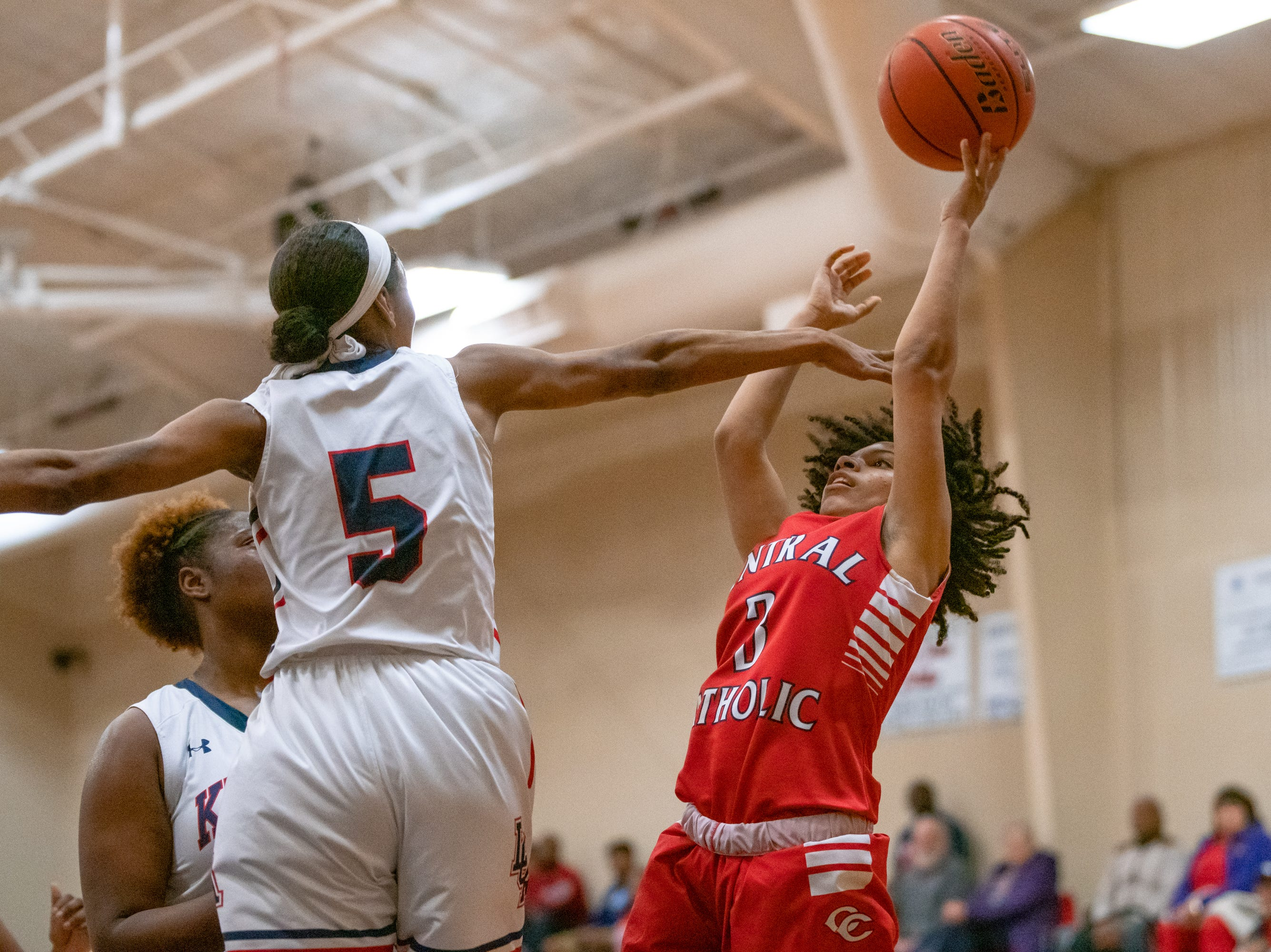 Central Catholic's Jay Bertrand takes a shot over a Lafayette Christian defender as the LCA Knights take on the Central Catholic Eagles at home on Thursday, Feb. 21, 2019.