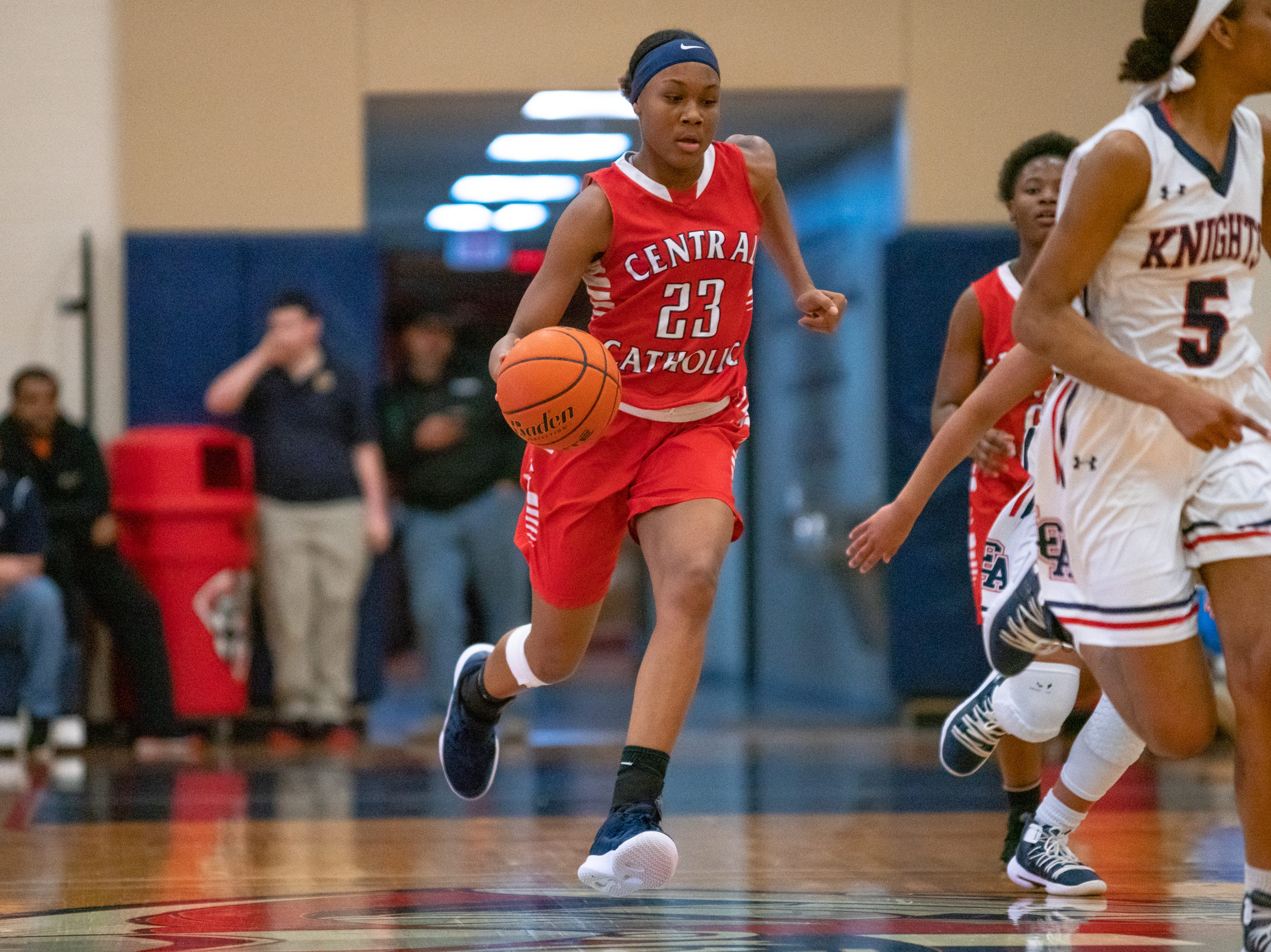 Central Catholic's Yani Johnson moves the ball down the court as the LCA Knights take on the Central Catholic Eagles at home on Thursday, Feb. 21, 2019.