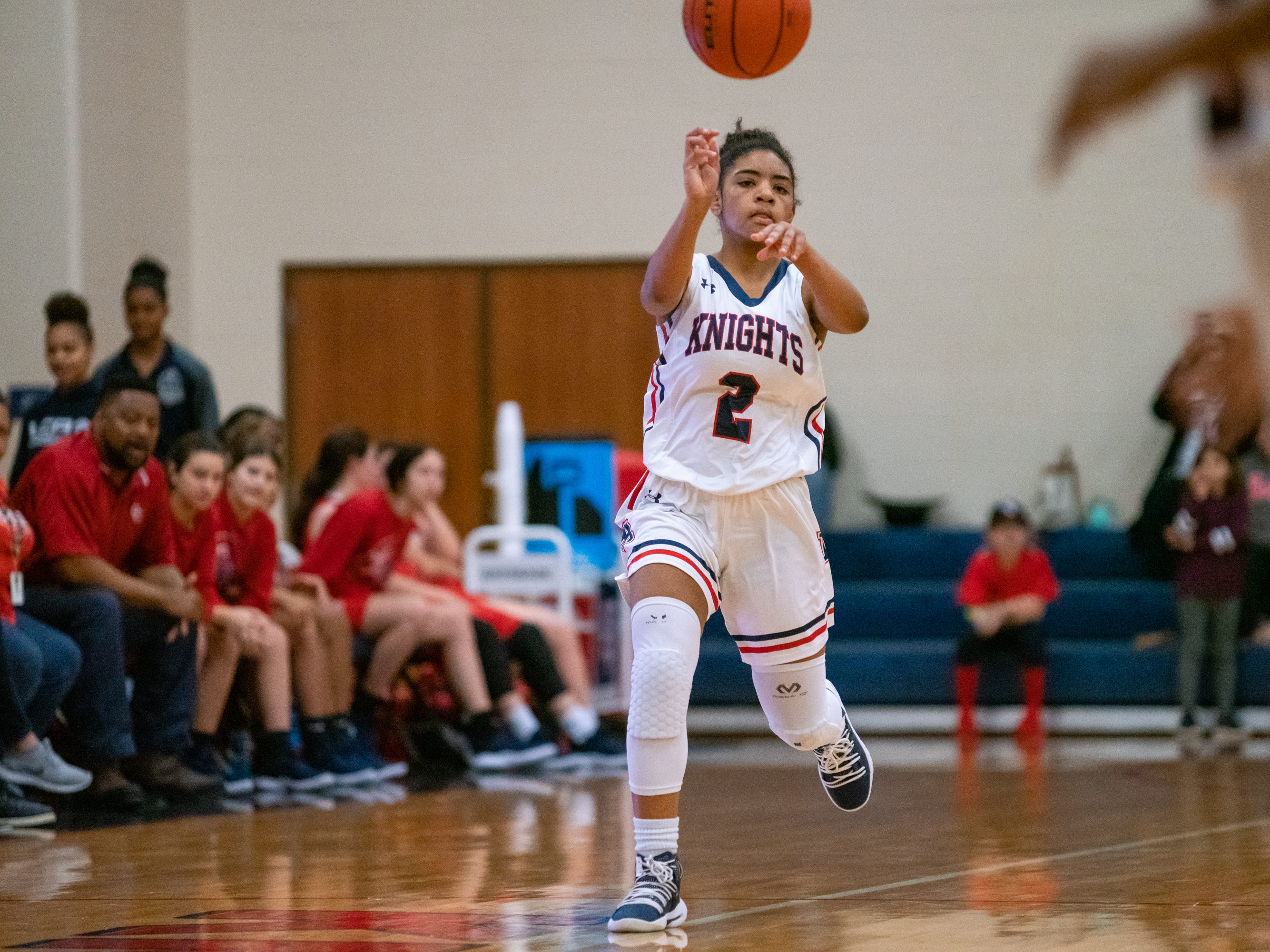 Lafayette Christian's Zoe Wiltz passes the ball down the court as the LCA Knights take on the Central Catholic Eagles at home on Thursday, Feb. 21, 2019.