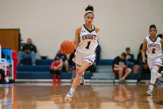 Lafayette Christian's Autumn Chassion brings the ball down the court as the LCA Knights take on the Central Catholic Eagles at home on Thursday, Feb. 21, 2019.