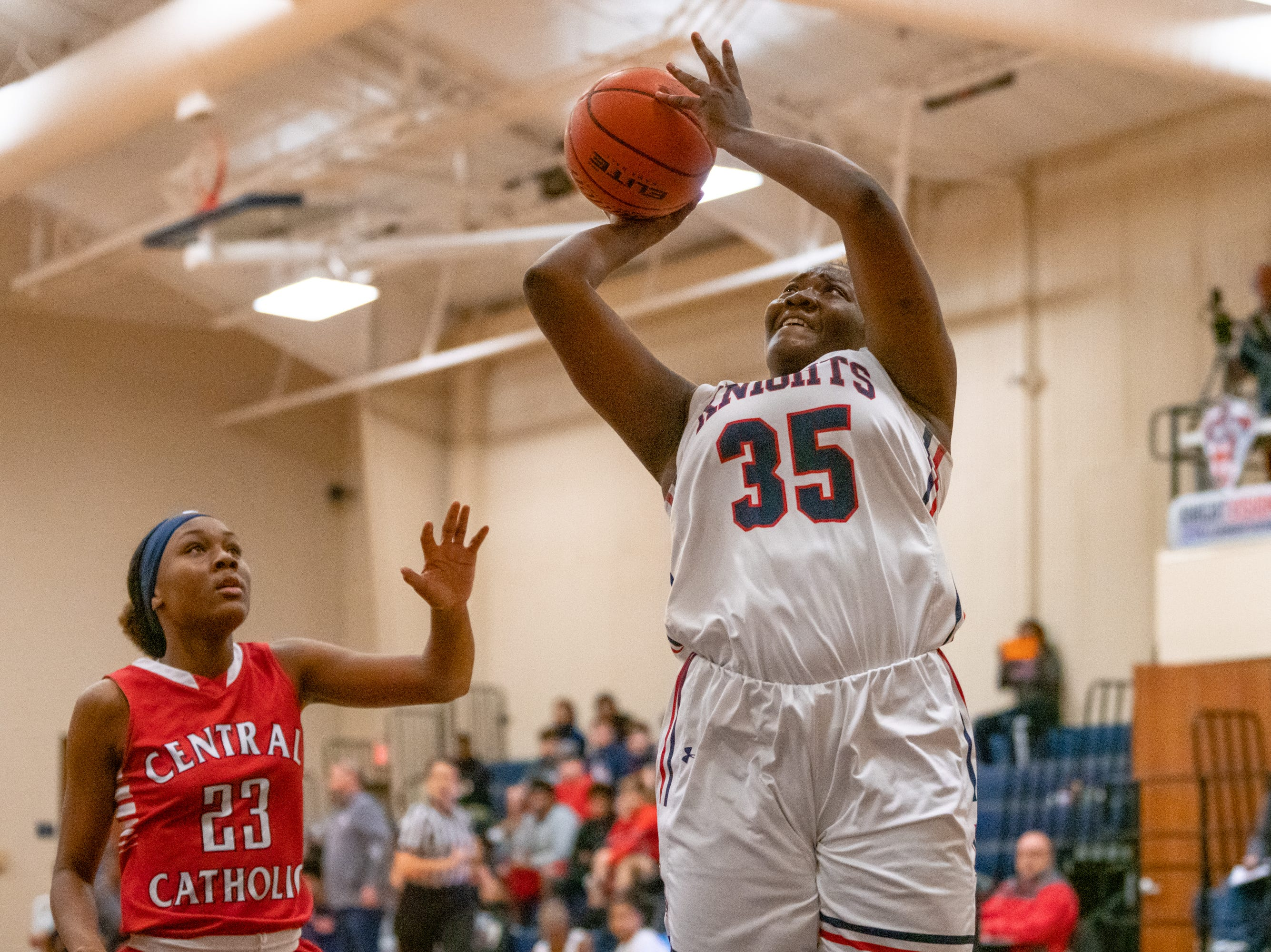 Lafayette Christian's Bré Porter takes a shot from under the goal as the LCA Knights take on the Central Catholic Eagles at home on Thursday, Feb. 21, 2019.