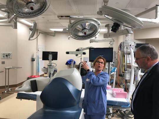 A surgeon explains some of the machines in the total joint room at the new orthopaedic general hospital in Lafayette, where patients can have joint replacement surgeries.