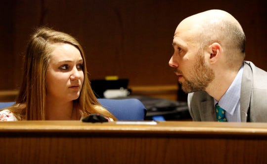 Katrine May Young, left, listens to her attorney Marcus Vanwey during Young's sentencing hearing Thursday, Feb. 21, 2019, in Fairfield County Common Pleas Court in Lancaster.