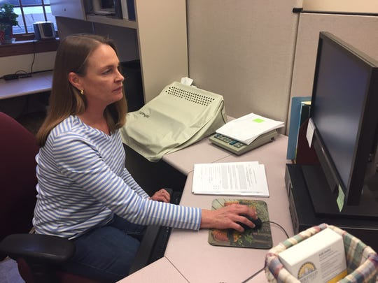 Fairfield County Court Services Coordinator Kelly Starkey types in notary public applications on Friday.
