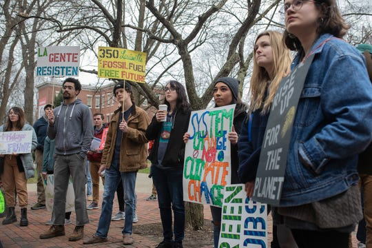 Attendees look on during a protest in support of the Green New Deal as well as climate and social justice on the U of L campus Friday. Feb. 22, 2019