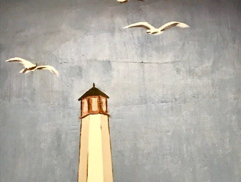 Restored section of Bentley mural showing lighthouse