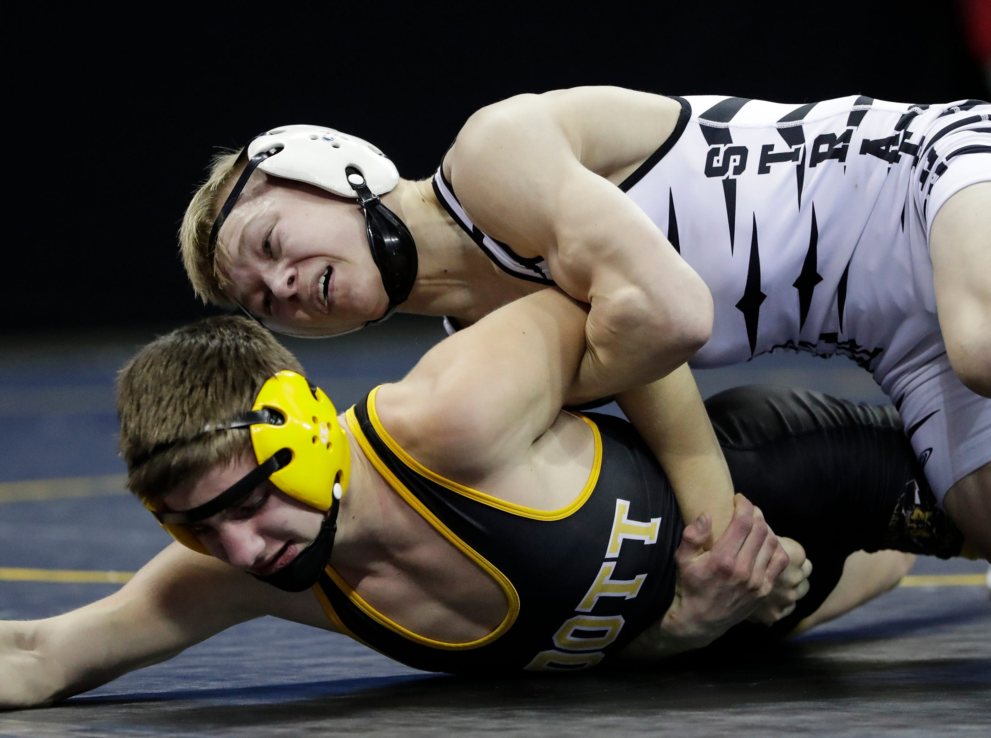 Stratford's Manny Drexler wrestles Cadott's Kaleb Sonnentag in a Division 3 120-pound weight class preliminary match during the WIAA state individual wrestling tournament at the Kohl Center Thursday, February 21, 2019, in Madison, Wis.