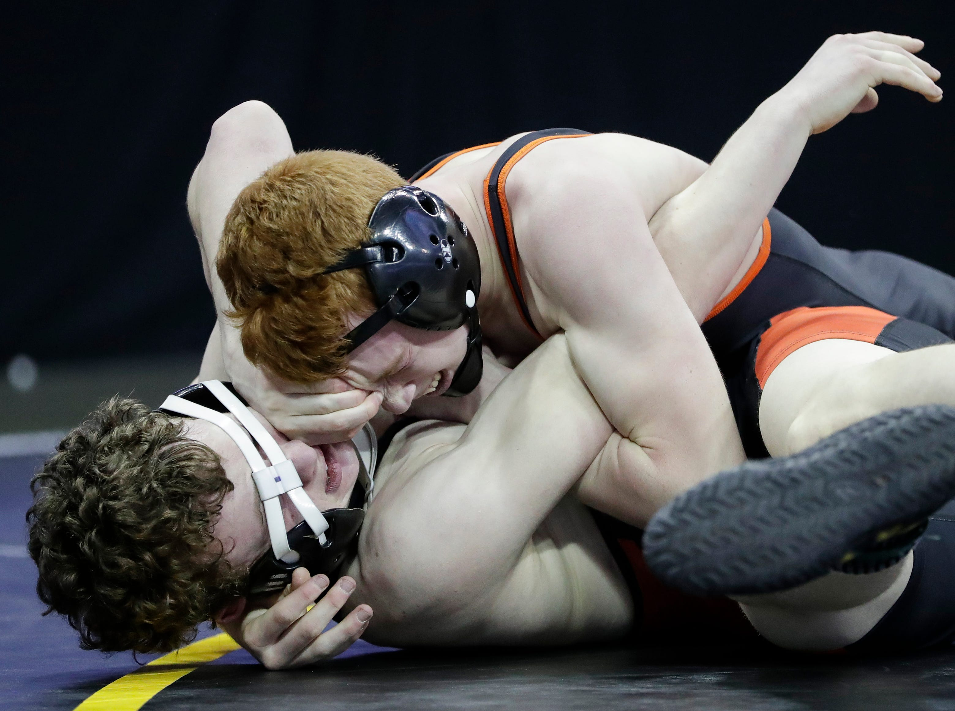 Mishicot's Brant Cracraft, top, pins Phillips' Hunter Bruhn in a Division 3 132-pound weight class preliminary match during the WIAA state individual wrestling tournament at the Kohl Center Thursday, February 21, 2019, in Madison, Wis.