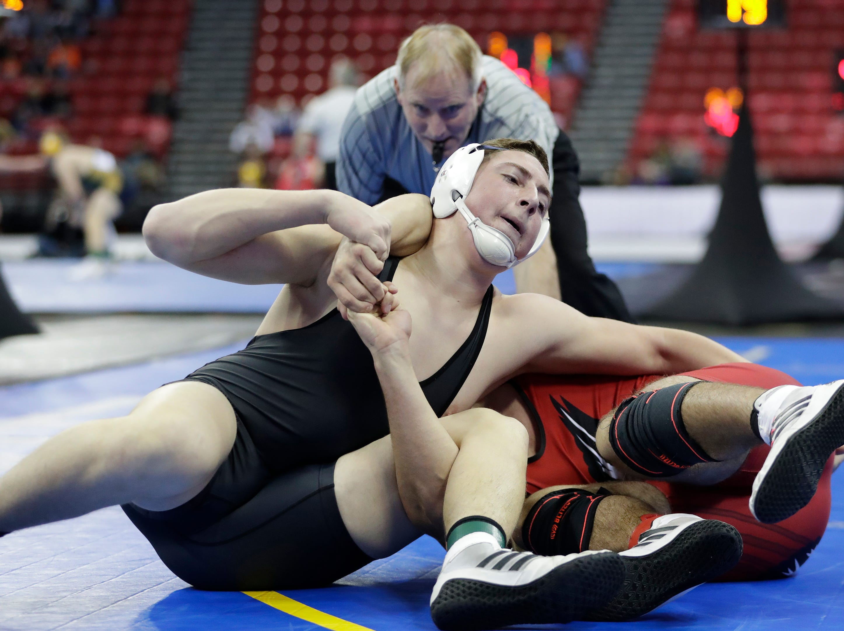 Stratford's Trevor Steiner wrestles Flambeau's Bryce Best in a Division 3 195-pound weight class preliminary match during the WIAA state individual wrestling tournament at the Kohl Center Thursday, February 21, 2019, in Madison, Wis.