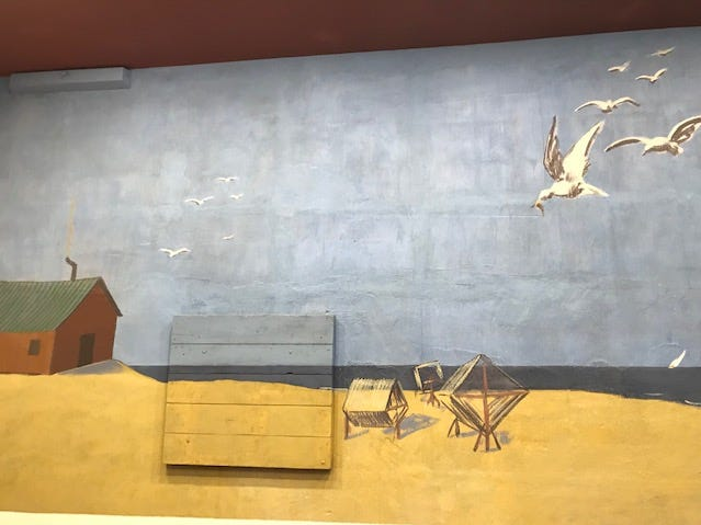 Restored part of Bentley mural showing shores of Lake Michigan