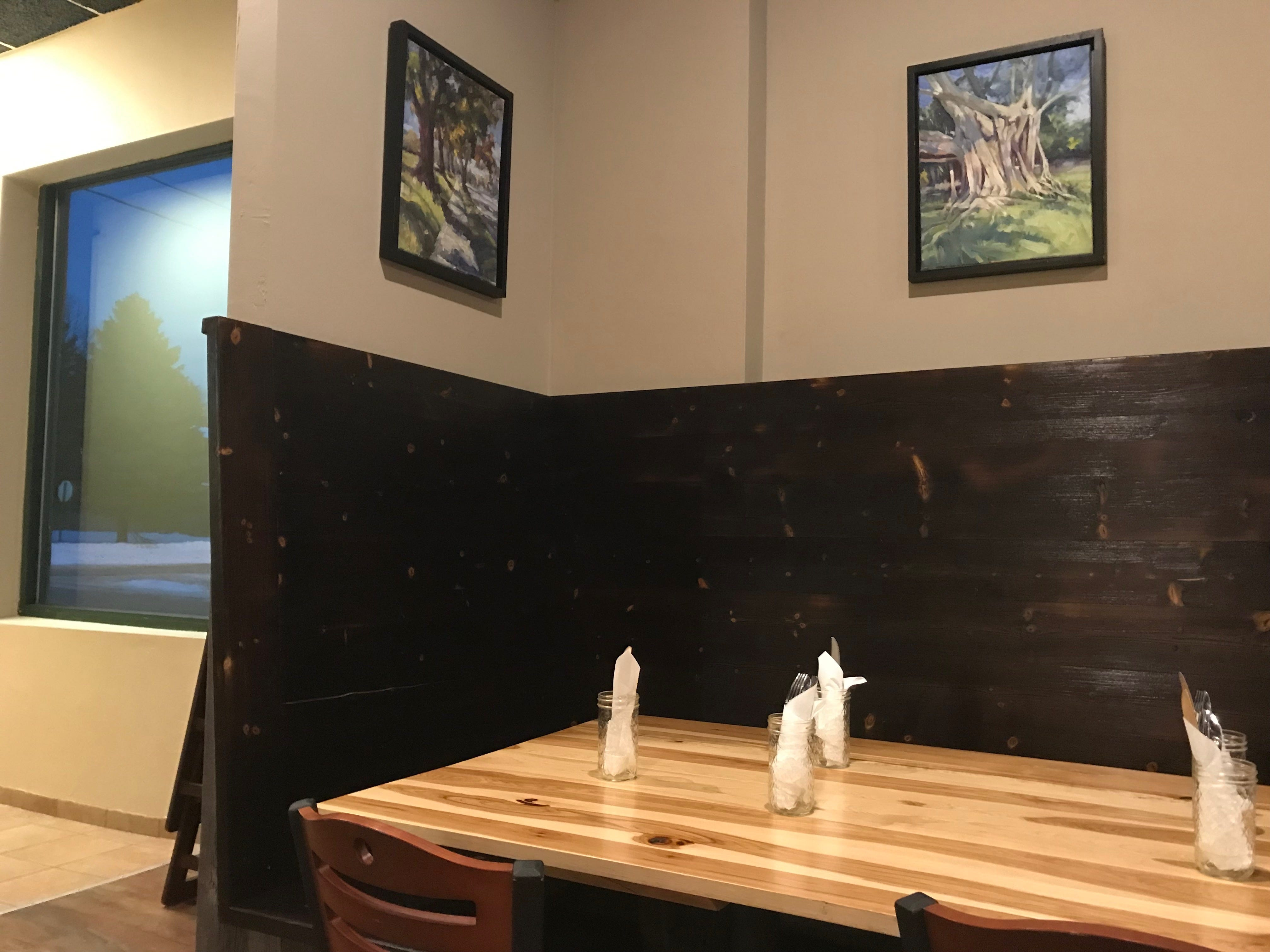 Holla dining room has a modern feel and displays local artwork.