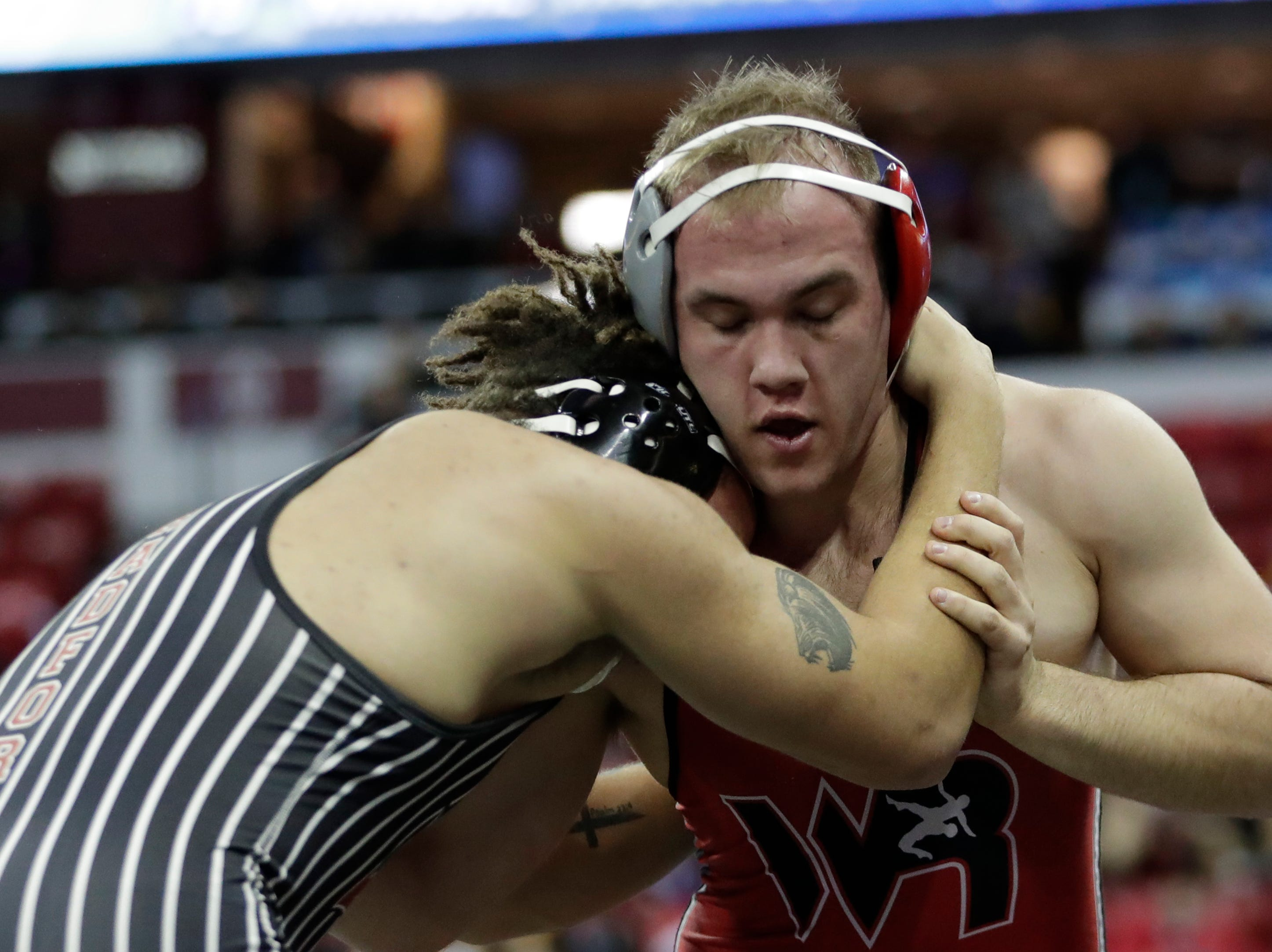 Wisconsin Rapids Lincoln's Layne Kalata wrestles Kenosha Bradford/Reuther's Kyle Bowens in a Division 1 220-pound weight class preliminary match during the WIAA state individual wrestling tournament at the Kohl Center Thursday, February 21, 2019, in Madison, Wis.