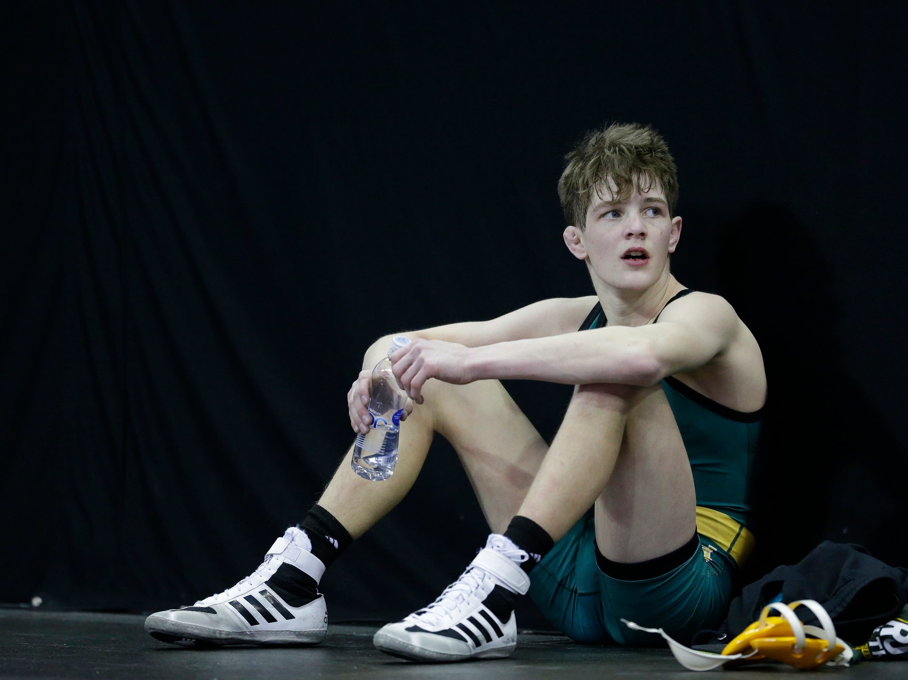 Ashwaubenon's Cody Minor rests after winning his Division 1 113-pound weight class quarterfinal match during the WIAA state individual wrestling tournament at the Kohl Center Thursday, February 21, 2019, in Madison, Wis.