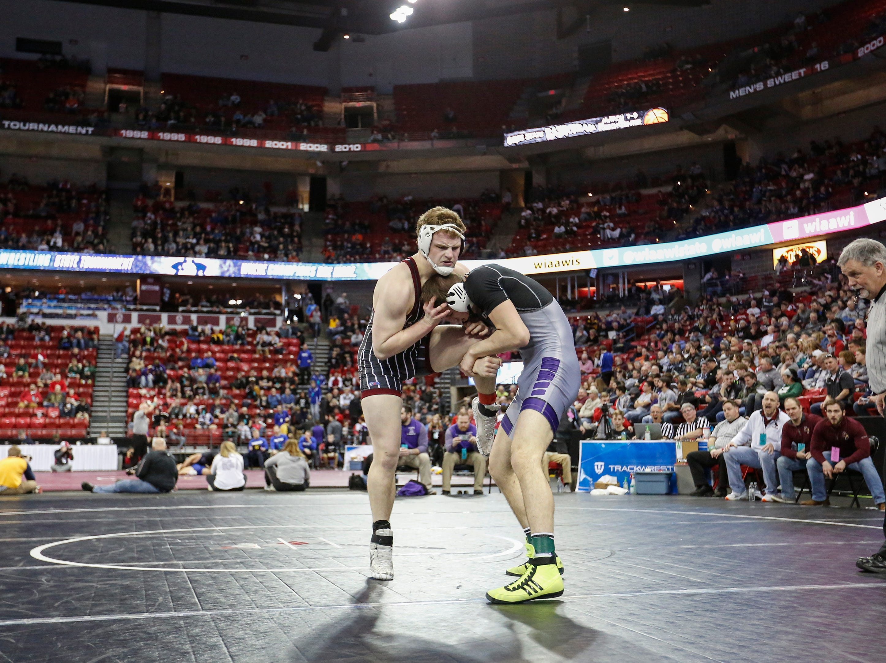 De Pere's Charlie Hooyman wrestles Beloit Memorial's Tyler Sireci in a Division 1 195-pound weight class preliminary match during the WIAA state individual wrestling tournament at the Kohl Center Thursday, February 21, 2019, in Madison, Wis.