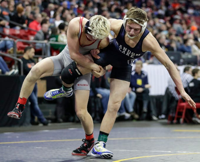Weyauwega-Fremont's Logan Kicherer takes down Random Lake's Joey Bock in a Division 3 145-pound weight class preliminary match during the WIAA state individual wrestling tournament at the Kohl Center Thursday, February 21, 2019, in Madison, Wis.